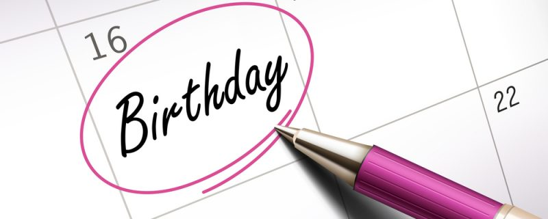 birthday word circle marked on a calendar by a pink ballpoint pen. 3D illustration