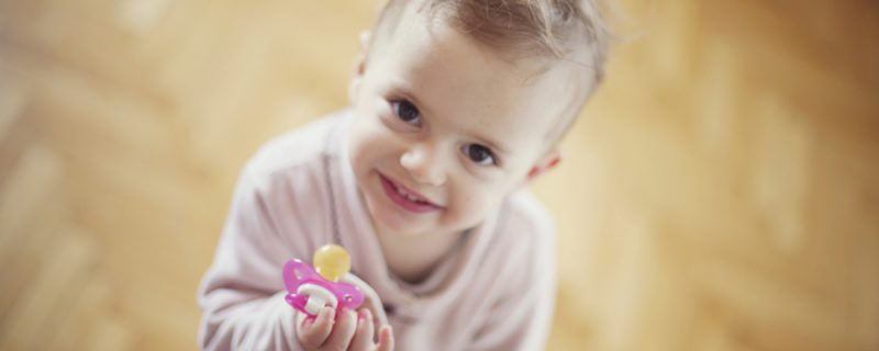 Cute toddler girl with pacifier